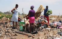 Community members in Alexandra gather their belongings after floods in the area on 10 November 2016. Picture: Christa Eybers/EWN.
