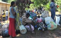 FILE: Malawian nationals rest next to their belongings after they were repatriated as they fled xenophobic violence in South Africa on April 21, 2015 at the Malawian Social welfare offices in Blantyre. Picture: AFP
