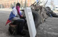 FILE: A pro-Russian activist guards a road block outside the regional Security Service building in Lugansk, eastern Ukraine. Picture: AFP.