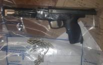A gun and bullets that were seized by police in Bishop Lavis. Picture: SAPS.