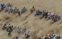 Motorcycles and quad bikes line up at the start of Dakar Rally. Picture: Supplied.