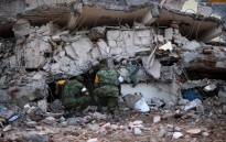 Soldiers with specially trained dogs search for survivors amid the ruins of buildings knocked down Thursday night by an 8.1-magnitude quake, in Juchitan de Zaragoza, Mexico, on 9 September 2017. Picture: AFP.