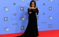 Oprah Winfrey poses with the Cecil B. DeMille Award in the press room during The 75th Annual Golden Globe Awards at The Beverly Hilton Hotel on 7 January, 2018. Picture. AFP