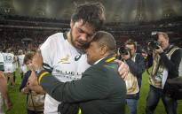 Springbok coach Allister Coetzee hugs an injured Warren Whitely after the team's victory over Ireland in the series decider in Port Elizabeth on 25 June 2016. Picture: Aletta Harrison/EWN.