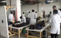 FILE: Doctors care for patients affected by Cholera at the Heroes stadium temporary transformed in a hospital on 15 January 2018 in Lusaka, Zambia. Picture: AFP.