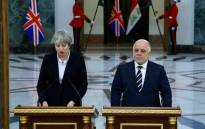A picture released by the Iraqi Prime Minister's office on 29 November, 2017 show Prime Minister Haider al-Abadi (R) delivering a press statement with British Prime Minister Theresa May in Baghdad. Picture: AFP.