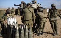 FILE: Israeli soldiers organise the 155mm shells during an exercise. Picture: AFP.