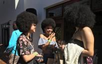 Naturilistas enjoying the sun at the Clicks Curls event on Saturday. Photo: Monique Mortlock