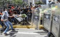 Venezuela's opposition activists clash with riot police agents during a protest against Nicolas Maduro's government in Caracas on April 4, 2017. Picture:  AFP.