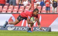 Sylvian Mahuza of the Emirates Lions scores a try during the SuperRugby match between Emirates Lions and Waratahs. Picture: AFP.