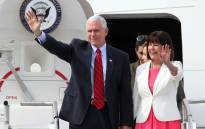 US Vice President Mike Pence and his wife Karen Pence wave as they arrive at the US Osan Air Base in Pyeongtaeck on April 16, 2017. Pence arrived in South Korea for a three-days visit where the nuclear issue will be top of the agenda at talks with South Korea's acting president Hwang Kyo-Ahn. Picture: STR / YONHAP / AFP.