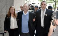 Harvey Weinstein arrives for arraignment at Manhattan Criminal Courthouse in handcuffs after being arrested and processed on charges of rape, committing a criminal sex act, sexual abuse and sexual misconduct on 25 May 2018 in New York City. Picture: AFP