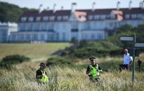 Police offficers stand guard outside Trump Turnberry, the luxury golf resort of US President Donald Trump, in Turnberry, southwest of Glasgow, Scotland on 14 July 2018, during the private part of his four-day UK visit. Picture: AFP.