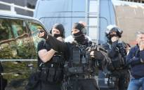 A member of the RAID French police unit gestures near the Tocqueville high school in the southern French town of Grasse, on March 16, 2017 following a shooting that left eight people injured. Picture: AFP