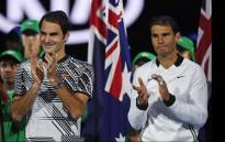 Switzerland's Roger Federer (L) and Spain's Rafael Nadal wait for the start of the awards ceremony after their men's singles final match on day 14 of the Australian Open tennis tournament in Melbourne on 29 January 2017. Picture: AFP