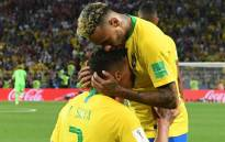 Brazil's defender Thiago Silva is congratulated on his goal by Brazil's forward Neymar during the Russia 2018 World Cup Group E football match between Serbia and Brazil at the Spartak Stadium in Moscow on 27 June, 2018. Picture: AFP.
