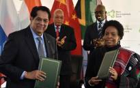 President of the NDB, Mr. Kundapur Vaman Kamath and Maite Nkoana-Mashabane signing agreements during the official launch of the African Regional Centre of the Brics New Development Bank in Sandton. Picture: GCIS.