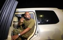 This file photo taken in 2011 shows Saif al-Islam Gaddafi appearing in front of supporters and journalists at his father's residential complex in Tripoli. Picture: AFP.