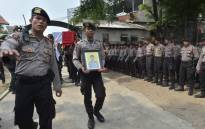 Indonesian policemen carry the coffin of a  police officer, who was killed late on 24 May in a suicide bombing, during a memorial ceremony in Jakarta on 25 May 2017.. Picture: AFP