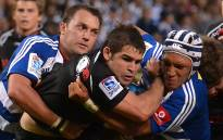 FILE: Sharks scrumhalf Cobus Reinach (in black) is tackled by Stormers players. Picture: Aletta Gardner/EWN