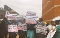 Learners from Nquthu protest outside the Pietermaritzburg High Court against the KZN Education Department demanding scholar transport on 7 November 2017. Picture : Ziyanda Ngcobo/EWN