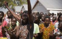 South Sudanese refugees cheer as the United Nations High Commissioner for Refugees visits the Nyumanzi transit centre in Adjumani, north of the capital Kampala on 29 August 2016. Picture: AFP.
