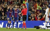 Barcelona's Sergi Roberto shown a red card for striking Madrid's Marcelo. Source: Twitter/@FCBarcelona