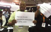 An ANC councillor in Tshwane holding a placard during a protest ahead of Mayor Solly Msimanga's State of the City address. Picture: Masa Kekana/EWN.