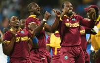 West Indiess captain Darren Sammy Dwayne Bravo and Chris Gayle celebrate after victory in the World T20 cricket tournament second semi-final match between India and West Indies at The Wankhede Stadium in Mumbai on 31 March, 2016. Picture: AFP.