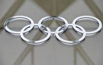 FILE: The Olympic logo in the building of the IOC headquarters in Lausanne. Picture: AFP
