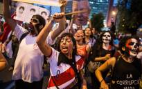 Demonstrators march during a protest against the pardon of former Peruvian President Alberto Fujimori in Lima, on 28 December, 2017. Picture: AFP
