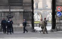 French police officers and soldiers patrol in front of the Louvre museum on February 3, 2017 in Paris after a soldier has shot and gravely injured a man who tried to attack him. Picture: AFP