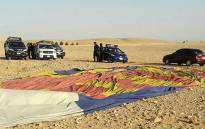 The remains of a hot air balloon are seen on the ground near the ancient city of Luxor after a fatal crash on 5 January 2018. Picture: AFP