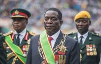 FILE: Zimbabwean President Emmerson Mnangagwa looks on after he was officially sworn-in during a ceremony in Harare on 24 November 2017. Picture: AFP.