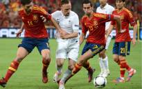FILE: Spanish midfielder Xabi Alonso (L) and Spanish defender Alvaro Arbeloa (R) tackle French midfielder Franck Ribery during the Euro 2012 football championships quarter-final match Spain vs France on June 23, 2012 at the Donbass Arena in Donetsk. Picture: AFP