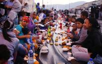 Parkwood residents sit in the middle of Blackbird Avenue enjoying their meals during a mass breaking of the fast on 13 June 2018. Picture: Bertram Malgas/EWN