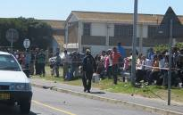 FILE: People watch on following a shooting in Lavender Hill. Picture: Shamiela Fisher/EWN