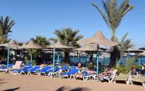 This file photo taken on January 9, 2016 shows tourists relaxing on the beach at the Bella Vista Hotel in Egypt's Red Sea resort of Hurghada. Picture: AFP.