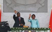 FILE: Angolan President Joao Lourenco and his wife Ana Dias de Lourenco wave to the crowd at the end of his swearing-in ceremonyon 26 September 2017 in Luanda. Picture: AFP.