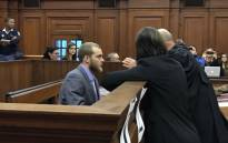 Family axe murderer Henri van Breda speaking to his lawyers during sentencing procedures at the Western Cape High Court on 5 June. Picture: Monique Mortlock/EWN