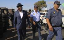 Police Minister Bheki Cele and Western Cape Police Commissioner Khombinkosi Jula visiting Browns Farms near Nyanga after the death of four people. Picture: Cindy Archillies/EWN.
