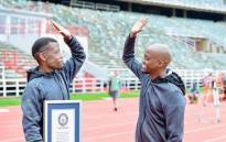 SA freestyle footballer Chris Njokwana (Left) set a new World Record for controlling a ball dropped from the highest altitude. Picture: Twitter/@KhristoJuggler.