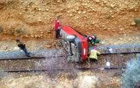 Officials on a scene where a car landed on a railway line between De Rust and Dysselsdorp in the Eden district on Sunday, 24 September 2017. Picture: Supplied.