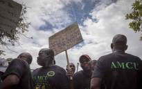 Amcu members outside the Brits Magistrates Court protest bail for the six murder accused appearing inside the court. Picture: Thomas Holder/EWN.