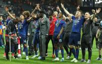 Manchester United's players celebrate after victory in the Uefa Europa League final football match Ajax Amsterdam v Manchester United on 24 May, 2017 at the Friends Arena in Solna outside Stockholm. Picture: AFP