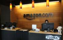 Nikol Szymul staffs a reception desk at Amazon offices discretely tucked into a building called Fiona in downtown Seattle, Washington on 11 May 2017. Picture: AFP.