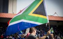 A man waves the South African flag at the Freedom Movement rally against the leadership of President Jacob Zuma in Pretoria on 27 April 2017. Picture: Reinart Toerien/EWN