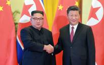 This picture taken on 19 June 2018 and released by North Korea's official Korean Central News Agency (KCNA) via KNS on June 20, 2018 shows North Korean leader Kim Jong Un (L) shaking hands with Chinese President Xi Jinping at the Great Hall of the People in Beijing. Picture: AFP