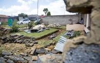 A young woman sits outside the remains of her family's house in Ennerdale after a tornado swept through the Johannesburg suburb on 14 November 2016. Picture: Reinart Toerien/EWN