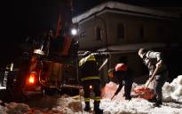 Rescuers remove snow on a road to the village of Penne, after an avalanche engulfed a mountain hotel in earthquake-ravaged central Italy, on January 19, 2017. Picture: AFP